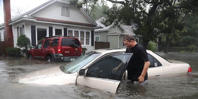 ST AUGUSTINE, FL - OCTOBER 07:  Rob Birch checks on his car which floated out of his drive way as Hurricane Matthew passes through the area on October 7, 2016 in St Augustine, Florida.  Florida, Georgia, South Carolina and North Carolina all declared a state of emergency in anticipation of Hurricane Matthew. (Photo by Joe Raedle/Getty Images)