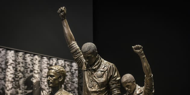 WASHINGTON, DC   SEPTEMBER 14: A statue depicting USA track and field athletes Tommie Smith, C, and John Carlos, R, as they raised gloved fists during their medal ceremony at the 1968 Summer Olympics is housed in the Sports Galleries at the Smithsonian Institute's National Museum of African American History and Culture, NMAAHC, on Wednesday, September 14, 2016, in Washington, DC.  The museum will open to the public on Saturday, September 24. (Photo by Jahi Chikwendiu/The Washington Post via Getty Images)