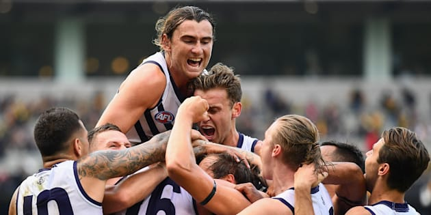 Somewhere in that ecstatic huddle is David Mundy, the veteran Freo Docker who kicked the winning goal against Richmond.