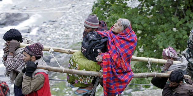 File photo of Kashmiri Muslim nomads carrying a Hindu pilgrim on a palanquin to the holy cave of Lord Shiva in Amarnath, 141 km southeast of Srinagar.
