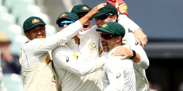 Australia's Matt Renshaw celebrates after taking a catch to dismiss South Africa's Hashim Amla.