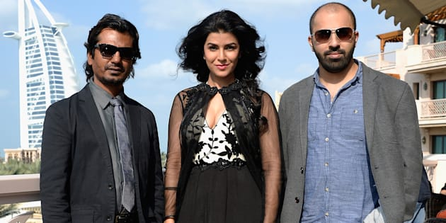 Nawazuddin Siddiqui, Nimrat Kaur and director Ritesh Batra attend the 'Lunchbox' photocall during day six of the 10th Annual Dubai International Film Festival held at the Madinat Jumeriah Complex on December 11, 2013 in Dubai. (Photo by Gareth Cattermole/Getty Images for DIFF)
