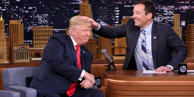 Republican Presidential Nominee Donald Trump gets a head rub during an interview with Jimmy Fallon on Sept. 15, 2016.