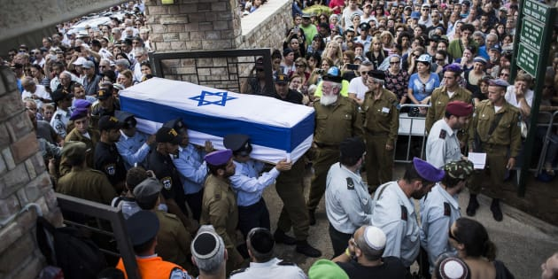 An honour guard caries the coffin of Israeli  Lt. Hadar Goldin during his funeral on Aug. 3, 2014 in Kfar-saba, Israel. Goldin was thought to have been captured during fighting in Gaza, but was later declared killed in action by the Israeli Defence Force (IDF).