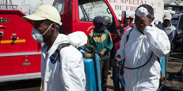 Council workers ready to start the clean-up operation of the market of Anosibe in the Anosibe district, one of the most unsalubrious district of Antananarivo on October 10, 2017. The World Health Organization has warned that a deadly outbreak of the plague, which began in late August, has claimed more than 20 lives in Madagascar and is swiftly spreading in cities across the country. Rats are porters of fleas which spread the bubonic plague and are attracted by garbages and unsalubrity. Pneumonic plague, which is passed through person-to-person transmission, has also been recorded.