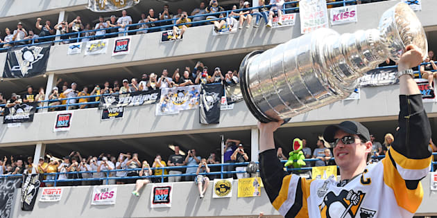 Sidney Crosby of the Pittsburgh Penguins hoists the Stanley Cup during the Victory Parade and Rally on June 14, 2017 in Pittsburgh, Pa.