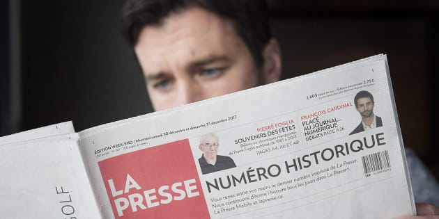 A man reads the final print edition of the French language newspaper La Presse at a coffee shop in Vaudreuil-Dorion, west of Montreal, Sat. Dec. 30, 2017. La Presse news group plans to adopt a not-for-profit structure, if Quebec allows it to do so, the company announced Tuesday.