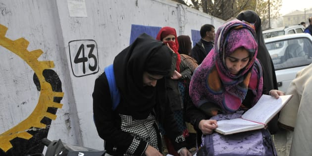 Students revise for the last time before entering exam centre as class 12 state board exams started in Kashmir amidst tight security on November 14, 2016 in Srinagar, India.