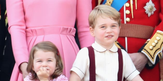 Prince George and Princess Charlotte look out from the balcony of Buckingham Palace during the Trooping the Colour parade in June 2017 in London, England.  (Photo by Chris Jackson/Getty Images)