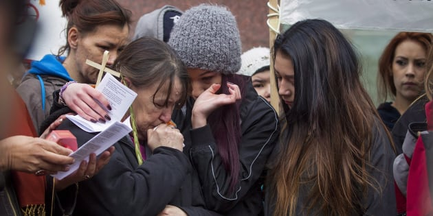 Family members embrace one another as protesters rally outside Edmonton's City Hall on Thursday, April 2, 2015 in support of Cindy Gladue. Alberta courts have ordered a new murder trial for Bradley Barton, the man accused of murdering Gladue. (Photo: Topher Seguin/CP Files)
