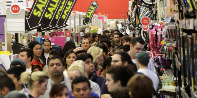 A crowd of shoppers browse at Target on the Thanksgiving Day holiday in Burbank, Calif., November 22, 2012. Canadians are growing frustrated with the hassle and cost of holiday shopping, but they're still planning to spend more this year than last, CIBC says.