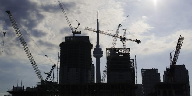 Condominiums under construction in Toronto, July 10, 2011. Data released on Friday showed urban construction starts for multiple-unit buildings, typically condos, surged 16.9 percent in November to 175,016 units, a record high even after a decades-long boom.