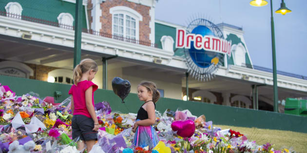 Community members paid tribute to the four dead at Dreamworld.