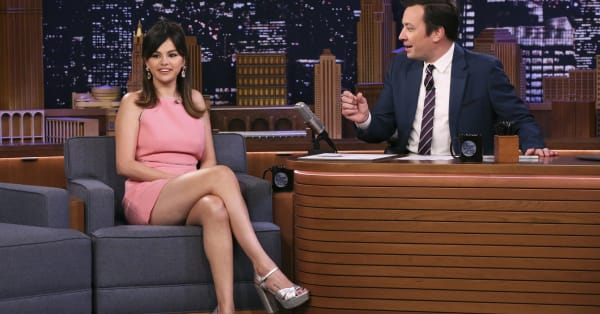 Selena Gomez channels modern day Twiggy in a pink Miu Miu mini-dress