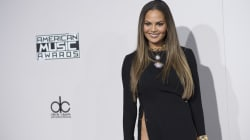 Chrissy Teigen and Heidi Klum Both A Little WTF On The AMA Red