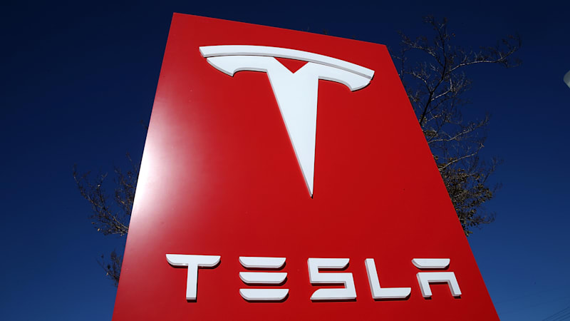 Tesla quarterly earnings fall short, but it posts first-ever annual profit