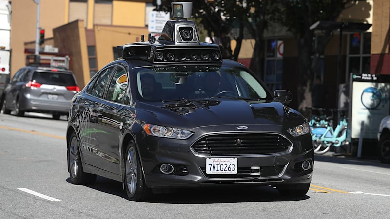 photo image California unveils revised rules on self-driving testing