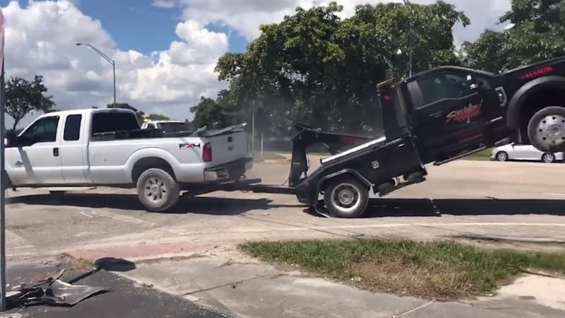 Video: Florida man plays tug of war as tow truck tries to