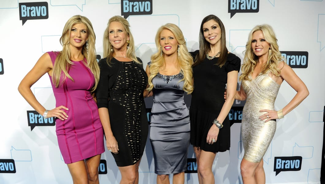 """Cast members for """"The Real Housewives of Orange County"""" from left, Alexis Bellino, Vicki Gunvalson, Gretchen Rossi, Heather Dubrow and Tamra Barney attend the Bravo network 2012 upfront presentation on Wednesday, April 4, 2012 in New York. (AP Photo/Evan Agostini)"""