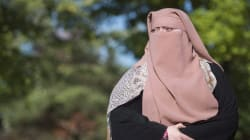 Quebec's Face-Covering Law Faces Court