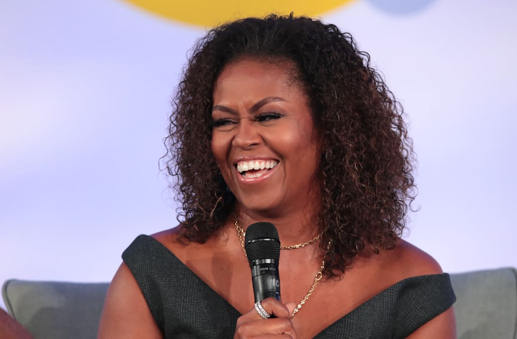 Michelle Obama applauded for rocking her natural curly hair while speaking at the Obama Foundation Summit - AOL