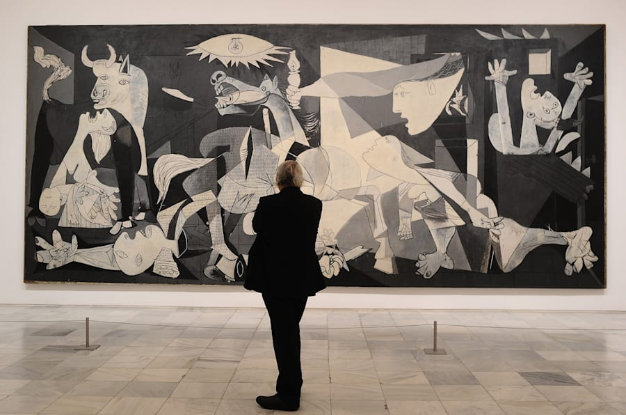 MADRID, SPAIN - APRIL 03:  View of Pablo Picasso's Guernica painting during the presentation to members of the press of the exhibition 'Pity and Terror in Picasso: The Path to Guernica' at the Museo Reina Sofia on April 3, 2017 in Madrid, Spain. The exhibition will celebrate the the 80th anniversary of Pablo Picasso's famous Guernica painting along with 150 masterpieces by the artist from the Reina Sofia's own collection and others from over 30 institutions around the world, including the Musee Picasso and Centre Georges Pompidou in Paris, the Tate Modern in London, the MoMA and the Metropolitan Museum of Art in New York, and the Beyeler Foundation in Basel.  (Photo by Denis Doyle/Getty Images)