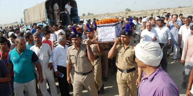 Sukma Martyr CRPF ASI Naresh Kumar's terrestrial body carried by CRPF personnel at his native village Jainpur Tikola.