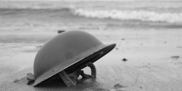 British Army Helmet left on the beach at Dunkirk after the retreat from the Germans 1940.re-enactment.