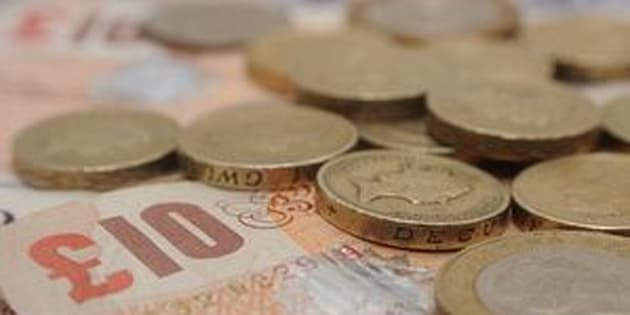 File photo dated 27/01/15 of a selection of one pound coins, two pound coins and bank notes, as sterling hit its highest level of the year late on Wednesday as traders continued to bet on Britain voting to remain in the EU.