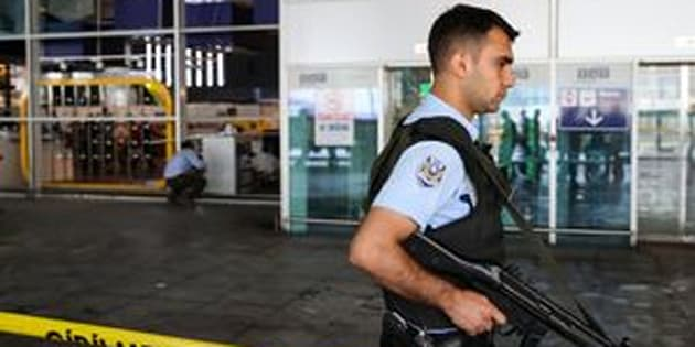 A Turkish police officer stands guard at IstanbulAtaturk Airport after air traffic returned to normal following the triple suicide bombing that killed 44 peopleon June 29.
