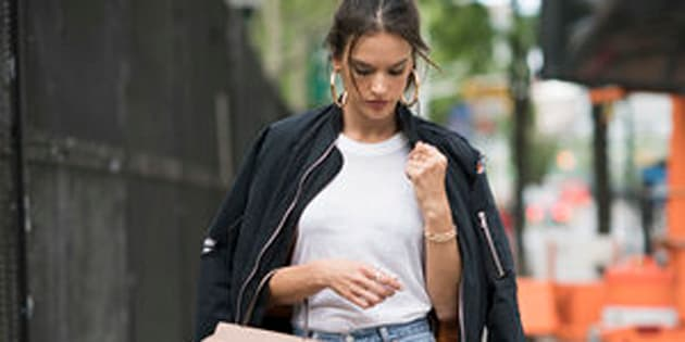NEW YORK, NY - MAY 22:  Alessandra Ambrosio is wearing  blue jeans pants from Redone, shoes by Gianvito Rossi, jewelry from Jenniffer Fisher, Todds bag, Tshirt from Redone and bomber jackets by Unravel in the streets of Manhattan on May 22, 2016 in New York, New York.  (Photo by Timur Emek/Getty Images)