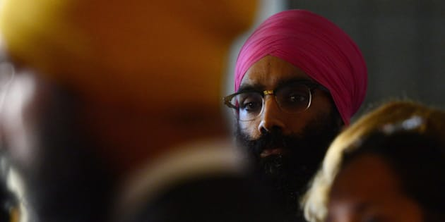 NDP Leader Jagmeet Singh, left, holds a press conference on Parliament Hill in Ottawa on Wednesday, Oct. 18, 2017, as his brother Gurratan Singh looks on.
