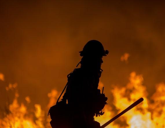 Firefighter killed battling massive California blaze