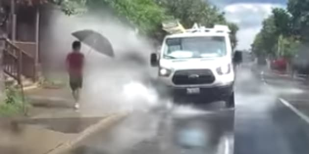 Van driver fired after being caught splashing pedestrians