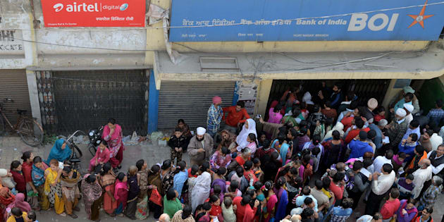 People queue outside a bank as they wait to deposit and exchange ₹500 and ₹1,000 notes in Amritsar on 13 November 2016.