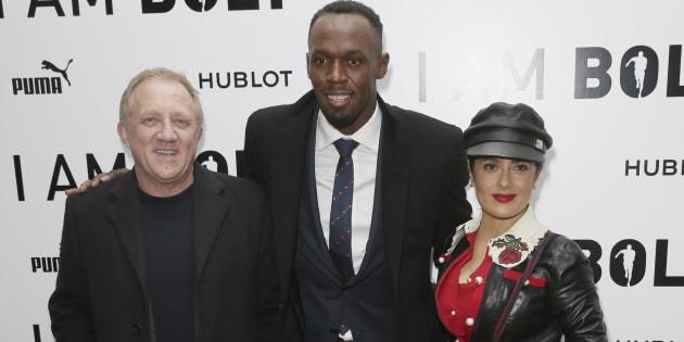 """Usain Bolt accompagné de Francois-Henri Pinault et de Salma Hayek pour la première mondiale du documentaire """"I Am Bolt"""" à Londres, le 28 novembre 2016."""