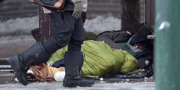 A homeless man sleeps in a doorway in Vancouver's Downtown Eastside, Dec. 19, 2016.