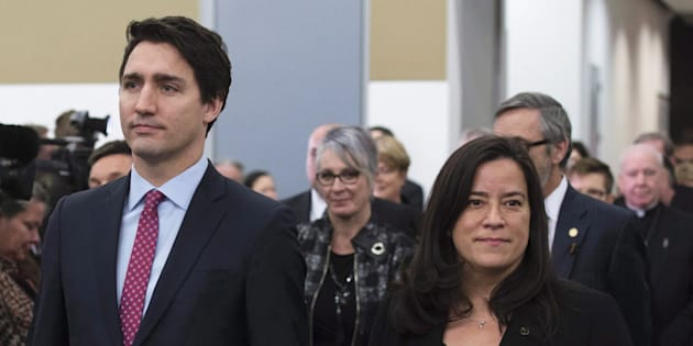 Prime Minister Justin Trudeau and Jody Wilson-Raybould take part in the grand entrance as the final report of the Truth and Reconciliation commission is released on Dec. 15, 2015 in Ottawa.