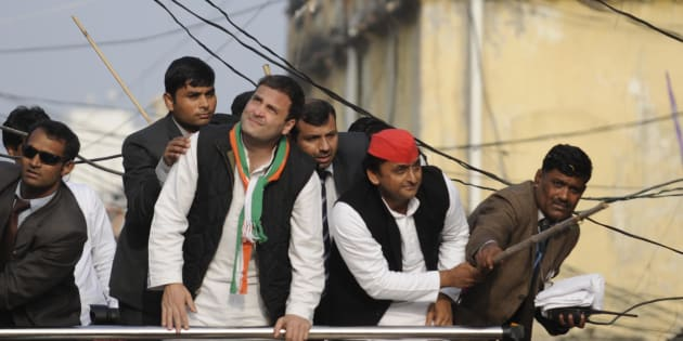 Uttar Pradesh chief minister and Samajwadi Party president Akhilesh Yadav and Congress vice president Rahul Gandhi saving themselves from electric wire during a road show on January 29, 2017 in Lucknow, India.