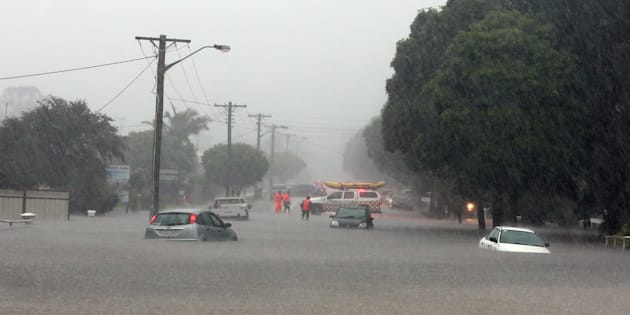 Cars caught in flood water in Albion Park Rail