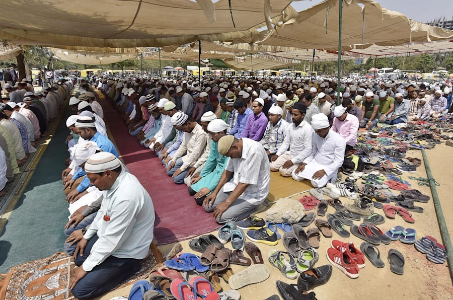 GURUGRAM, INDIA - MAY 11: Muslims offer Namaz at on a ground in Leisure Valley under police protection on May 11, 2018 in Gurugram, India. The mosques were overcrowded and many worshippers arrived late, being unfamiliar with the route, as Gurgaon held Friday namaz in 47 designated places under police protection rather than 100-odd spots as before.