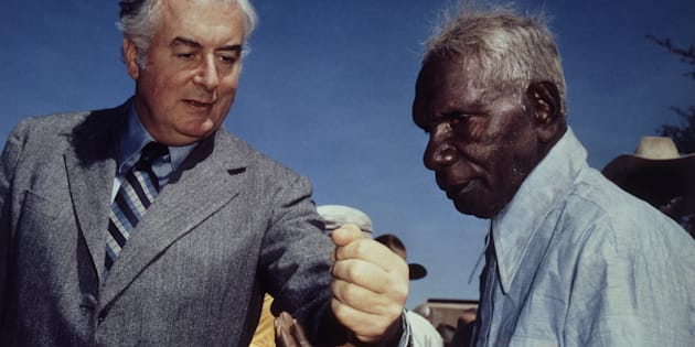 Prime Minister Gough Whitlam pours soil into the hands of traditional landowner Vincent Lingiari, Northern Territory on August 17, 1975.