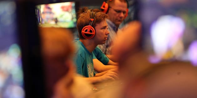 Visitors play the game 'World of Warcraft'??at the computer and video games fair Gamescom in??Cologne, Germany, 05 August 2015.  ANSA/OLIVER??BERG