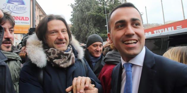 Il candidato premier del M5S Luigi Di Maio insieme al presidente del Potenza calcio Salvatore Caiata (S) in una foto a Potenza del 10 febbraio 2018.. ANSA/TONY VECE.