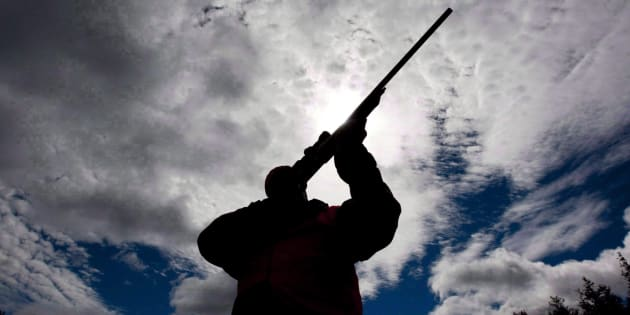 A rifle owner checks the sight of his rifle at a hunting camp property in rural Ontario, west of Ottawa, on Sept. 15, 2010.