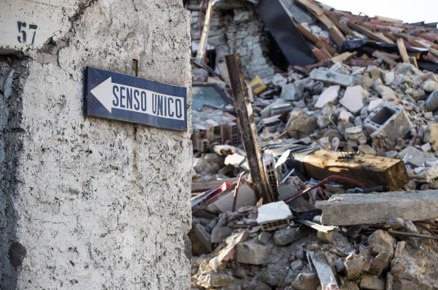 Le macerie delle palazzine crollate a causa del terremoto del 24 agosto 2016, lungo Via Roma. Amatrice, 1 agosto 2017. ANSA/MASSIMO PERCOSSI