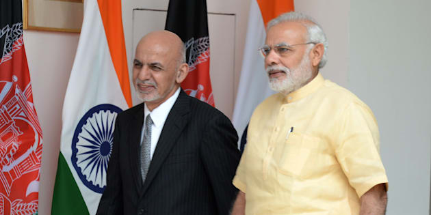 Afghan President, Asharf Ghani (L) arrives with Indian Prime Minister Narendra Modi.
