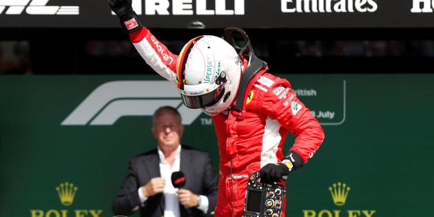 Formula One F1 - British Grand Prix - Silverstone Circuit, Silverstone, Britain - July 8, 2018   Ferrari's Sebastian Vettel celebrates winning the race   Action Images via Reuters/Matthew Childs