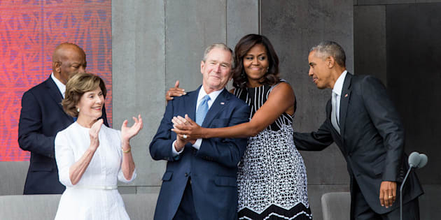 TOPSHOT - (L-R) Former US First Lady Laura Bush, former US President George W. Bush, First Lady Michelle Obama, and President Barack Obama attend the opening ceremony for the Smithsonian National Museum of African American History and Culture on September 24, 2016 in Washington, D.C.   / AFP / ZACH GIBSON        (Photo credit should read ZACH GIBSON/AFP/Getty Images)