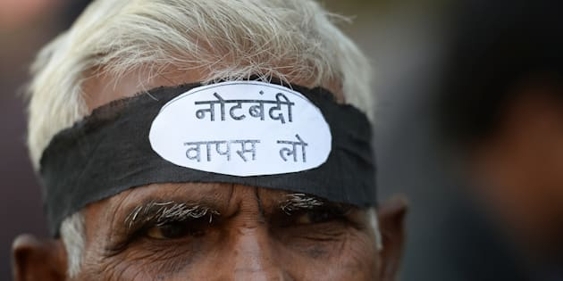 An activist from the Communist Party of India wearing a headband shouts slogans against the government of Prime Minister Narendra Modi during a protest against demonetisation in New Delhi on November 28, 2016.
